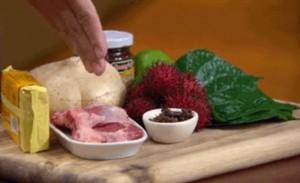 Luke's box of jicama, rambutan, shrimp paste, goat cutlets, lime, betel leaves, tamarind puree and crickets.